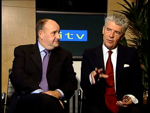 vídeos de stock e filmes b-roll de granada and carlton merger approved; itn michael green interviewed sot - sometimes to compete upmarket is much more reliable than to compete... - confiabilidade