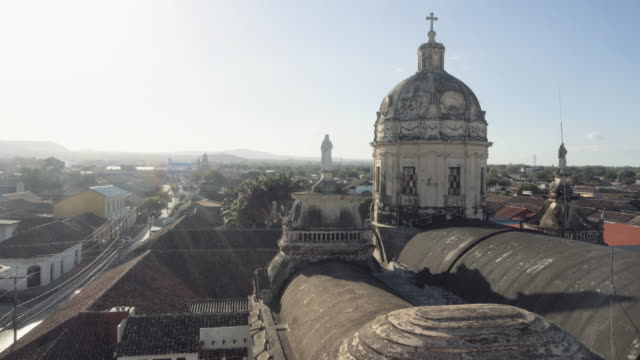 granada - nicaragua establishing shot. skyline from the vantage point of the bell tower la merced church. in this 4k video we can see the roof of the church, an old dome and typical tile roof of the city - nicaragua stock videos & royalty-free footage