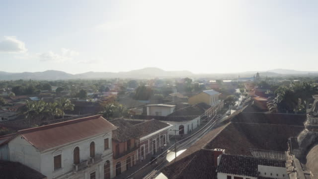 granada - nicaragua establishing shot. skyline from the vantage point of the bell tower la merced church. in this 4k video we can see the roof of the church, an old dome and typical tile roof of the city - nicaragua stock videos and b-roll footage