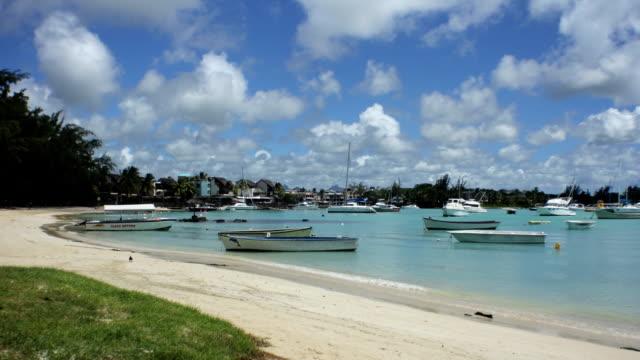 grand baie public beach time lapse 1b - sunny video stock e b–roll