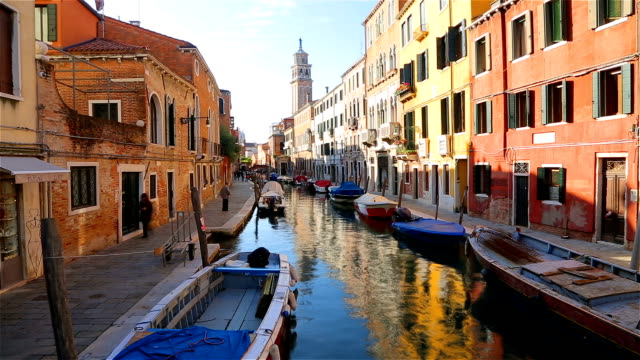 grand canal and colorful facades of old medieval houses in venice, italy. - grand canal venice stock videos & royalty-free footage