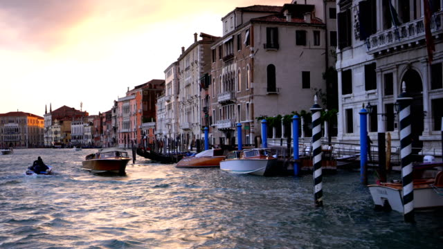 grand canel with traditional venetain buildings on the background - venice italy stock videos & royalty-free footage