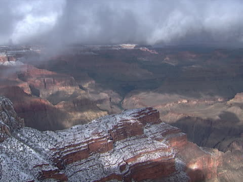 vidéos et rushes de grand canyon: snow and clouds' shadows - exposé aux intempéries