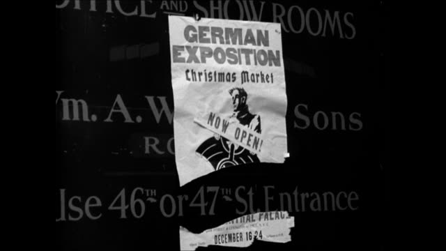 grand central palace building w/ 'german exposition christmas market now open' sign. people picketing outside building, 'boycott nazi goods',... - northern european stock videos & royalty-free footage
