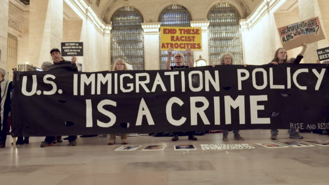 "grand central station: activist from rise and resist hold sings read ""close the camps"" and signs that read ""abolish ice"" . rise and resist has been... - undocumented immigrant stock videos & royalty-free footage"
