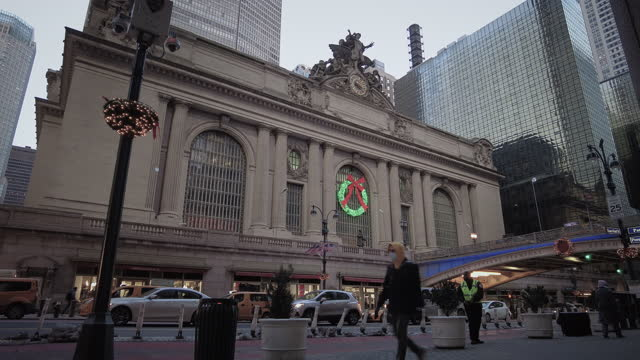 grand central station exterior with people during coronavirus . people walking by wearing face masks. christmas decoration wreath on the building... - yellow taxi stock videos & royalty-free footage