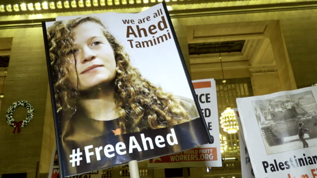 grand central station – grand hall palestinian and israeli activist and supporters protest the arrest of ahed tamimi a 16yearold palestinian girl... - palestine girl stock videos and b-roll footage