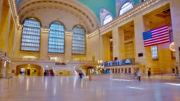 Grand Central Terminal during the pandemic. Empty, calm. American flag. Social distancing, state of emergency.