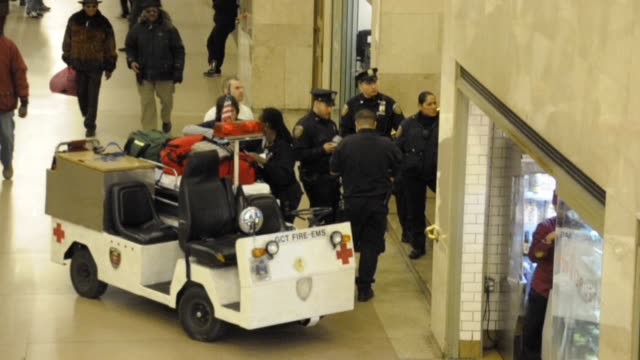 grand central terminal gct fire-ems assisting a person. grand central terminal gct fire-ems assisting a pe on january 07, 2013 in new york city, new... - golf cart stock videos & royalty-free footage