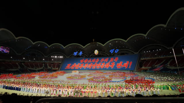 tl grand finale with amazingly many performers and firework during mass games in pyongyang north korea dprk wide shot - spoonfilm stock videos and b-roll footage