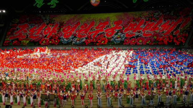 grand finale with amazingly many performers during mass games in pyongyang, north korea, dprk. medium wide shot - north korea stock videos & royalty-free footage
