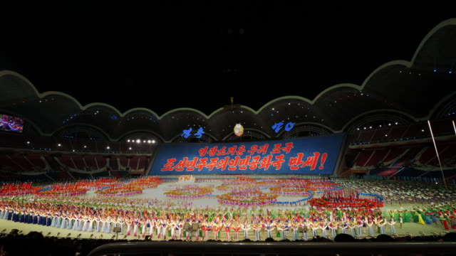 grand finale with fireworks during mass games in pyongyang, north korea, dprk. wide shot - north korea stock videos & royalty-free footage