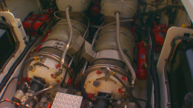 grand haven, michiganman checking boat engine - portello video stock e b–roll