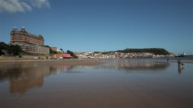 grand hotel, beach, castle & lighthouse - scarborough uk stock videos & royalty-free footage