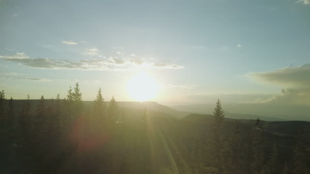 grand mesa national forest late evening sunset forest fire smoke on horizon 4k video series - evergreen tree stock videos & royalty-free footage