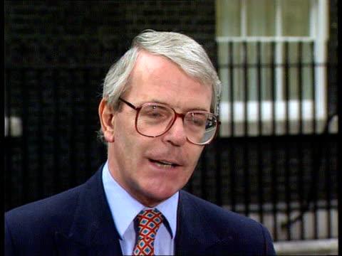 Grand National cancelled IRA bomb threats ENGLAND London Downing Street EXT LMS PM John Major towards ZOOM IN MS press CMS Major pkf cynical IRA /...