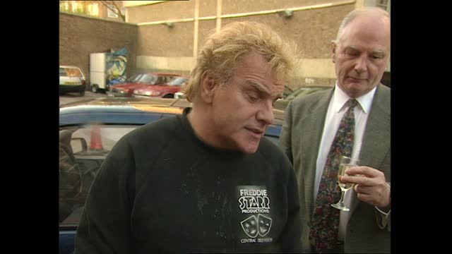 freddie starr photocall with champagne; england: london: croydon: ext as car stops and freddie starr falls out of car cms freddie starr interview sot... - spraying stock videos & royalty-free footage