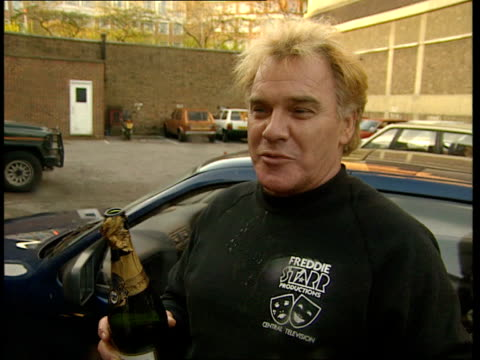 Location Unknown CMS Freddie Starr drinking from bottle of champagne BV Press as Starr with champagne by car Freddie Starr intvw SOT They all watched...