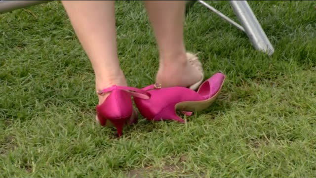 grand national preview / ladies' day fashions england liverpool aintree ladies day ext close shot of pink high heel shoes worn by woman racegoer... - platform shoe stock videos and b-roll footage