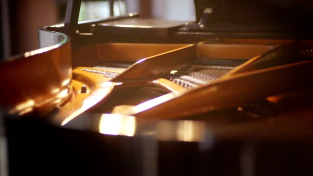 grand piano inside with strings. - piano stock videos & royalty-free footage
