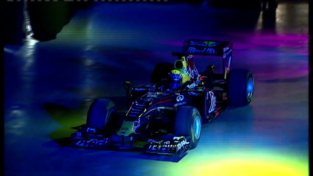 grand prix: formula one teams refuse to participate; date and location unknown: formula one car driven along through coloured lights new mclaren... - grand prix motor racing stock videos & royalty-free footage