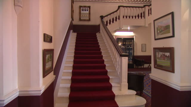 Grand staircase, red carpet and white banister, Norfolk, England