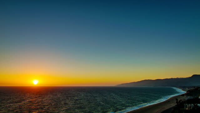 grand sunset over california - malibu beach stock videos & royalty-free footage