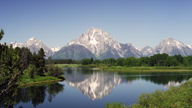 grand teton mountains and reflection in lake - grand teton stock videos & royalty-free footage