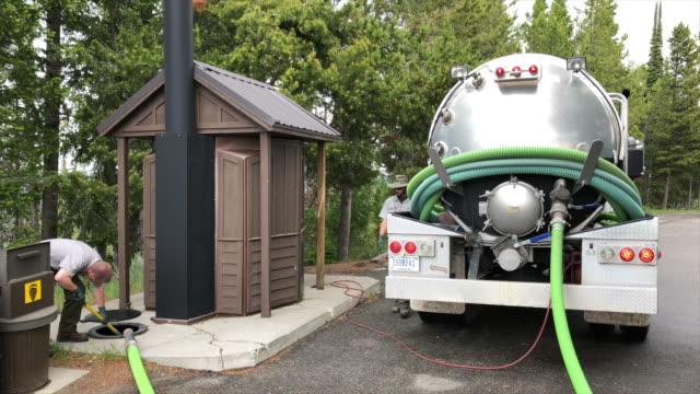 grand teton national park employees draining toilet waste. - grand teton national park stock videos & royalty-free footage