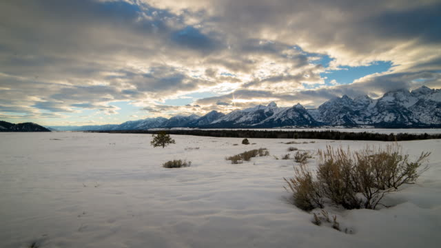 grand teton national park winter sunset time lapse - grand teton stock-videos und b-roll-filmmaterial