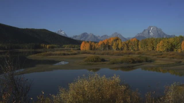 grand teton overlooks jackson lake. - grand teton stock videos & royalty-free footage