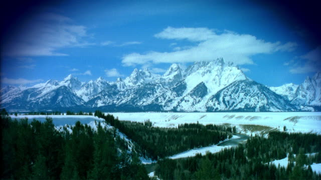 t/l ws grand tetons in winter with snake river in foreground / jackson, wyoming, usa - river snake stock videos & royalty-free footage