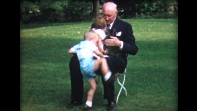 1958 grandad holds two children on lap