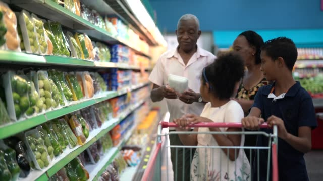 grandchild and grandparents buying on supermarket - choice stock videos & royalty-free footage