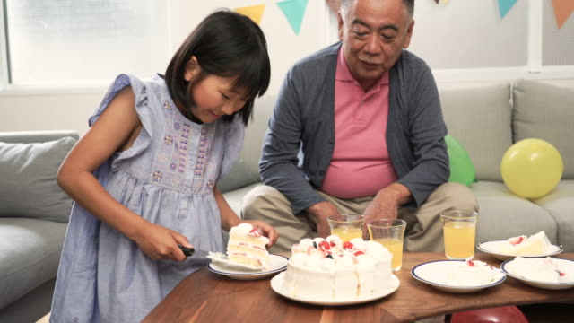 Grandchild cutting cake by oneself