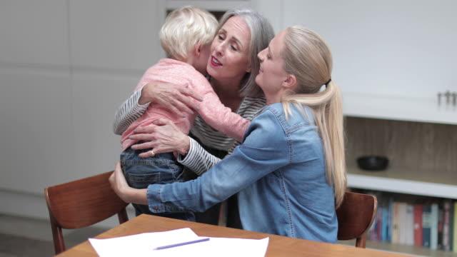 vídeos y material grabado en eventos de stock de grandchild giving grandmother a hug goodbye - abuela