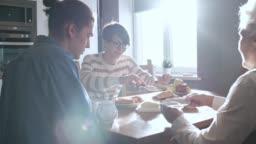 Grandchildren and Grandmother Enjoying Breakfast