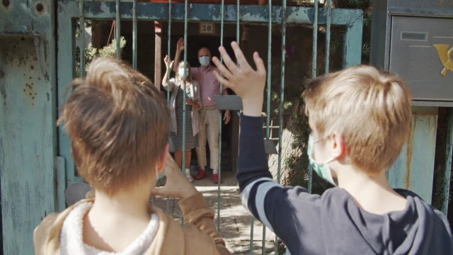 grandchildren waving to their grandparent during covid-19 quarantine - distant stock videos & royalty-free footage