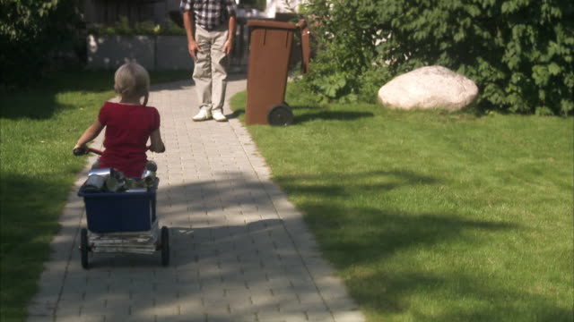 granddaughter and grandfather recycling cans, sweden. - trailer stock videos & royalty-free footage