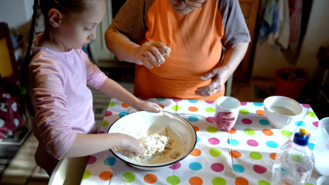 granddaughter kneading homemade dough - rolling pin stock videos & royalty-free footage