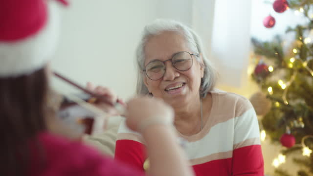 granddaughter playing violin for grandmother - pinaceae stock videos & royalty-free footage