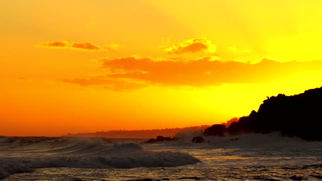 Grande Anse Beach, waves on sunset - Reunion Island