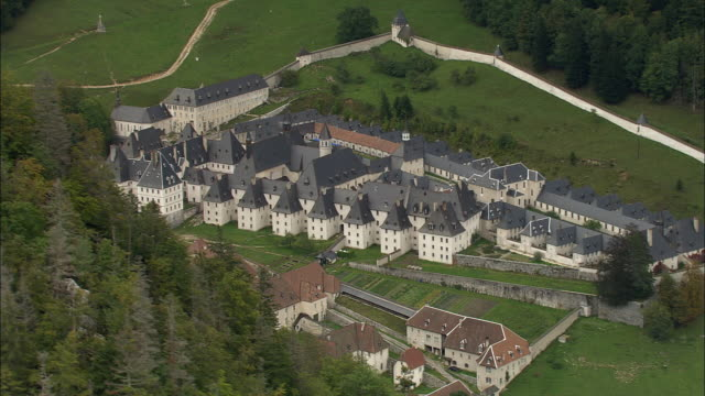 aerial ws zi zo grande chartreuse carthusian monastery in chartreuse mountains / saint-pierre-de-chartreuse, isere, france - circa 12th century stock videos & royalty-free footage