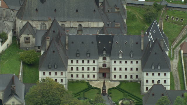 aerial ws grande chartreuse carthusian monastery in chartreuse mountains / saint-pierre-de-chartreuse, isere, france - circa 12th century stock videos & royalty-free footage