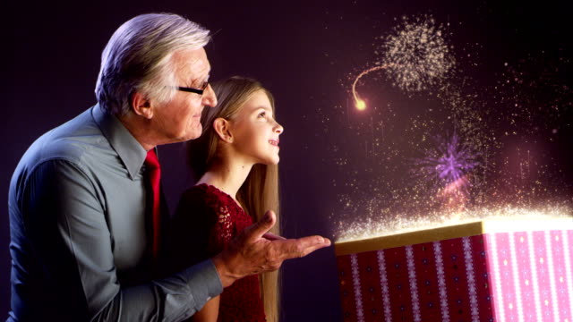 grandfather and granddaughter opening christmas gift - little girls flashing stock videos and b-roll footage