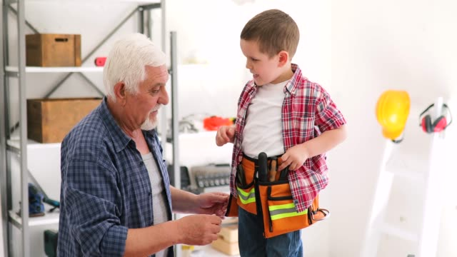 grandfather and grandson in workshop - bricolage video stock e b–roll
