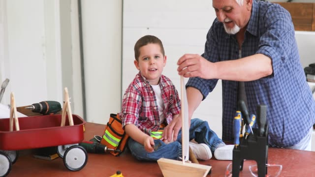 grandfather and grandson in workshop - art and craft stock videos & royalty-free footage