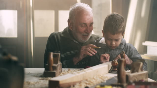 Grandfather and grandson in workshop