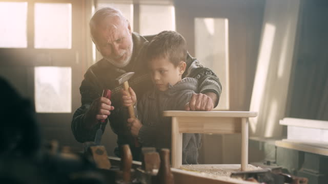 grandfather and grandson in workshop - grandfather stock videos & royalty-free footage