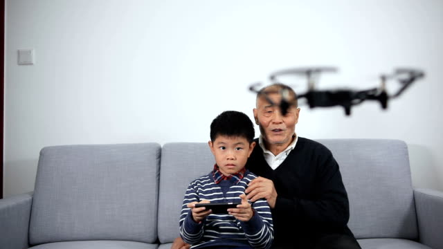 grandfather and grandson playing with drone - control stock videos & royalty-free footage